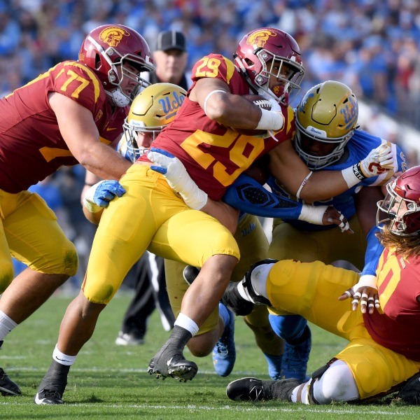 Players from the USC Trojans and the UCLA Bruins play football at the Rose Bowl on Nov. 17, 2018, in Pasadena. (Credit: Harry How/Getty Images)