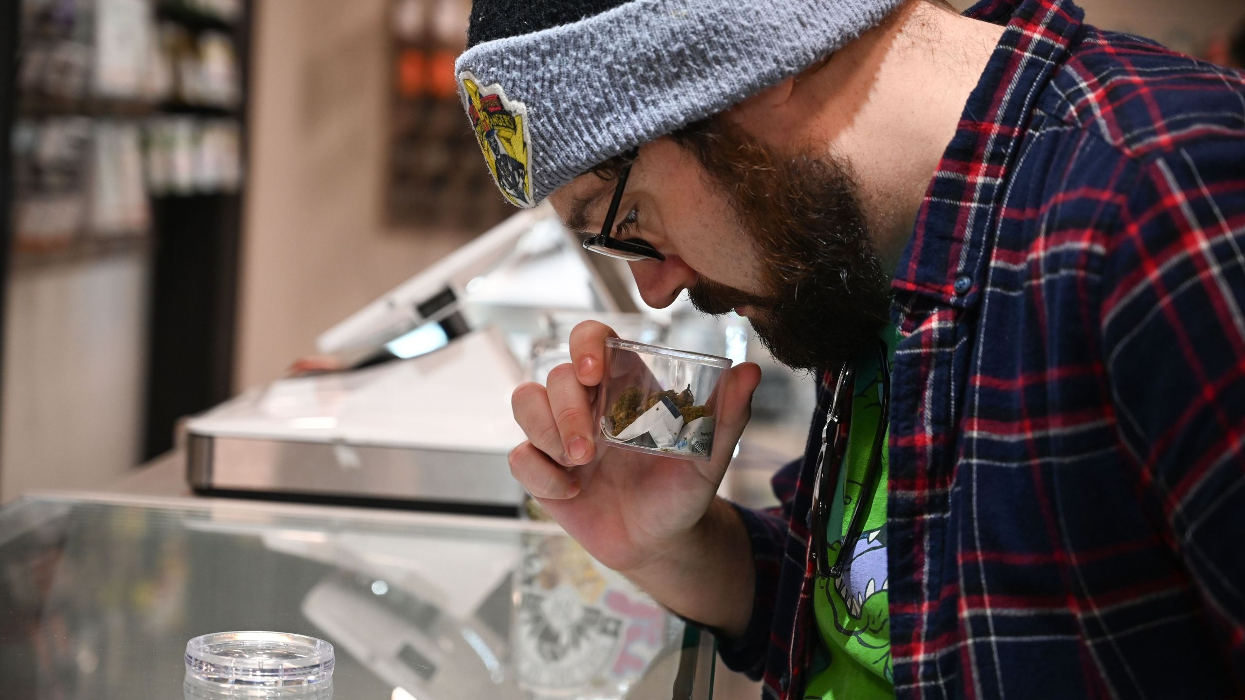 Cannabis tourist Dan Chlebanowski smells marijuana for sale at a dispensary in Los Angeles on Jan. 24, 2019. (Credit: Robyn Beck / AFP / Getty Images)