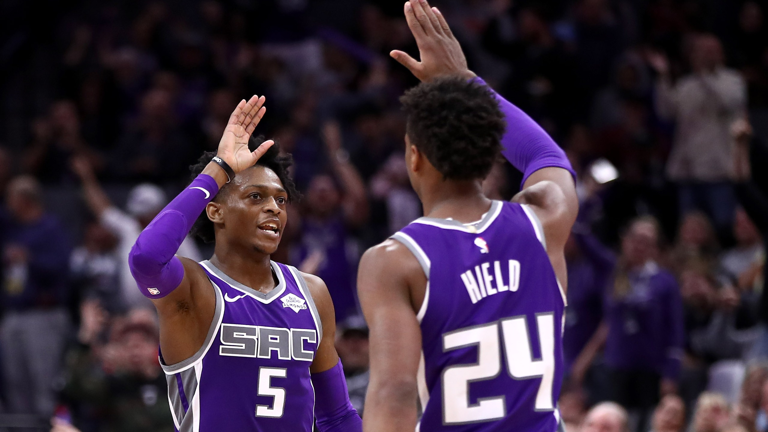 De'Aaron Fox #5 high-fives Buddy Hield #24 of the Sacramento Kings during their game against the Portland Trail Blazers at Golden 1 Center on Jan. 14, 2019, in Sacramento. (Credit: Ezra Shaw/Getty Images)