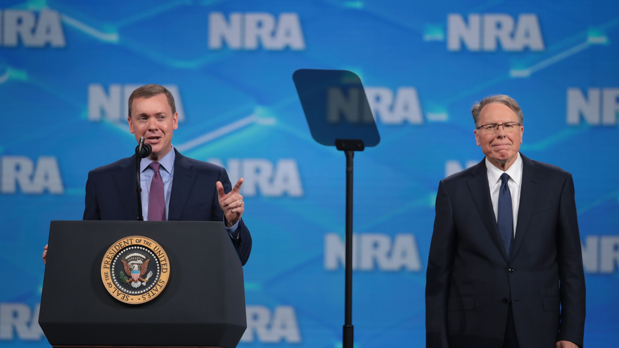 Chris Cox (L), executive director of the NRA-ILA, and Wayne LaPierre, NRA vice president and CEO, speak to guests at the NRA-ILA Leadership Forum at the 148th NRA Annual Meetings & Exhibits on April 26, 2019 in Indianapolis, Indiana. (Credit: Scott Olson/Getty Images)