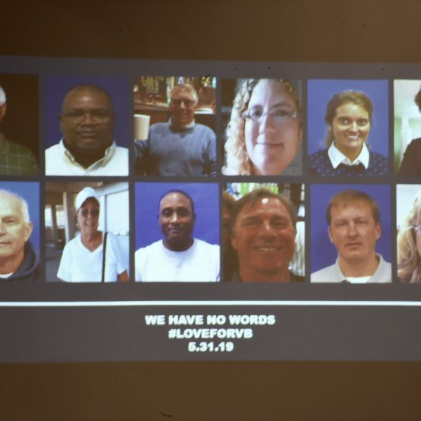 A slide of the victims in the May 31, 2019 mass shooting at a Virginia Beach, Virginia municipal building is shown during a press conference on June 1, 2019. (Credit: ERIC BARADAT/AFP/Getty Images)