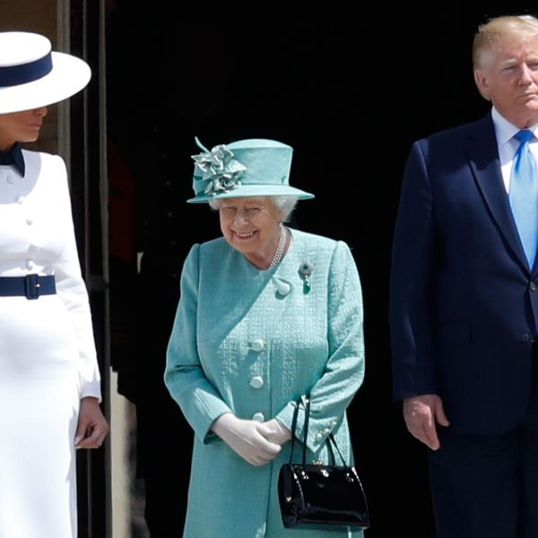 Britain's Queen Elizabeth II (C) stands with US President Donald Trump (R) as US First Lady Melania Trump (L) during a welcome ceremony at Buckingham Palace in central London on June 3, 2019. (Credit: ADRIAN DENNIS/AFP/Getty Images)