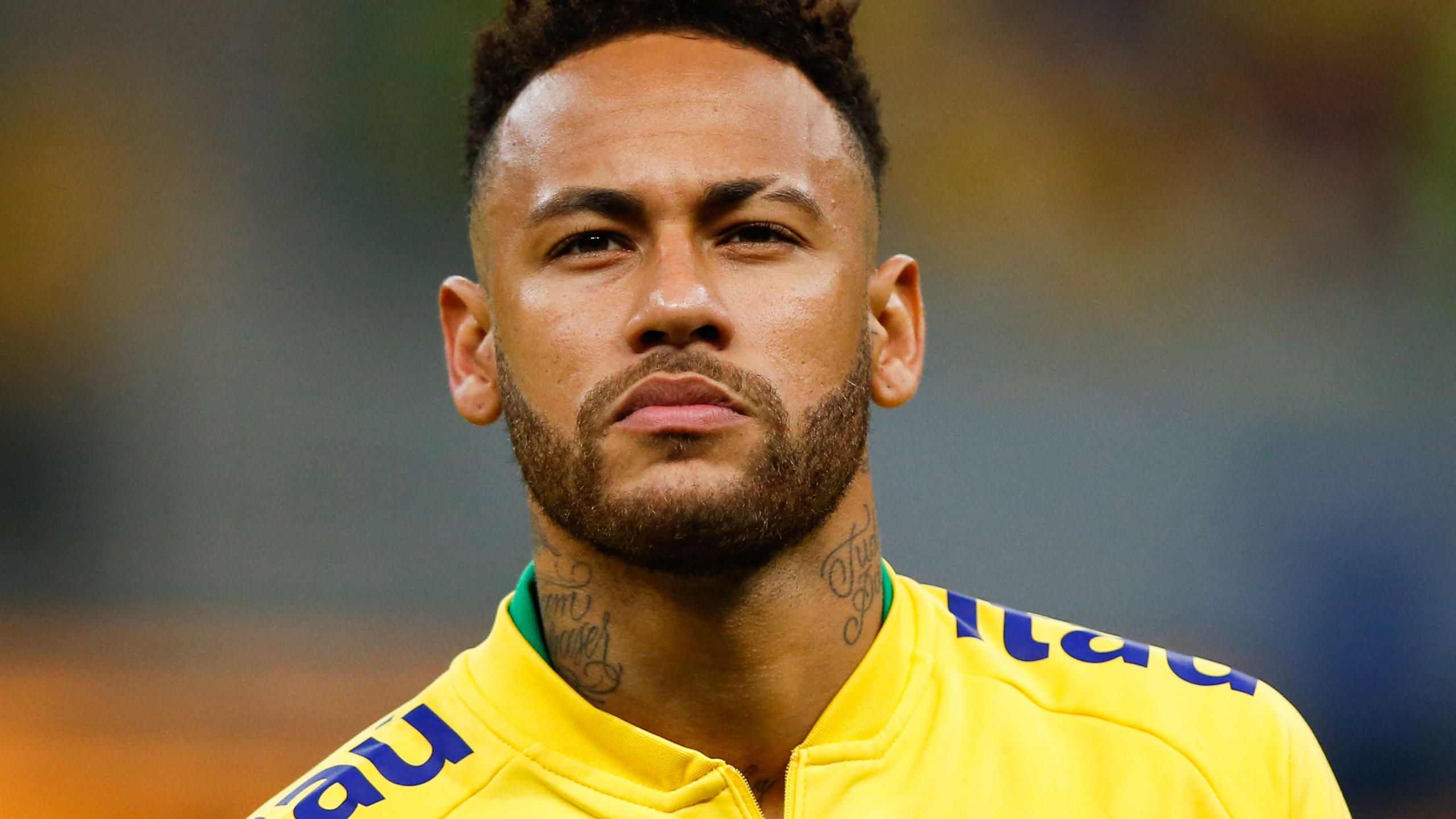 Neymar Jr. of Brazil looks on during the national anthem before the friendly match against Qatar at Mane Garrincha Stadium on June 5, 2019, in Brasilia, Brazil. (Credit: Alexandre Schneider/Getty Images)