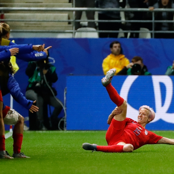 United States' forward Megan Rapinoe celebrates after scoring a goal during the France 2019 Women's World Cup Group F football match between USA and Thailand, on June 11, 2019, at the Auguste-Delaune Stadium in Reims, eastern France. (Credit: THOMAS SAMSON/AFP/Getty Images)