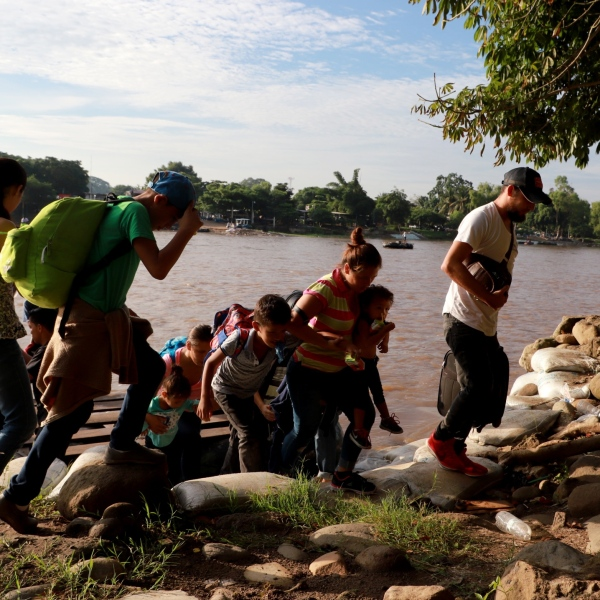Migrants and residents use a makeshift raft to illegally cross the Suchiate river, from Tecun Uman in Guatemala to Ciudad Hidalgo in Mexico on June 14, 2019. (Credit: Quetzalli Blanco / AFP / Getty Images)