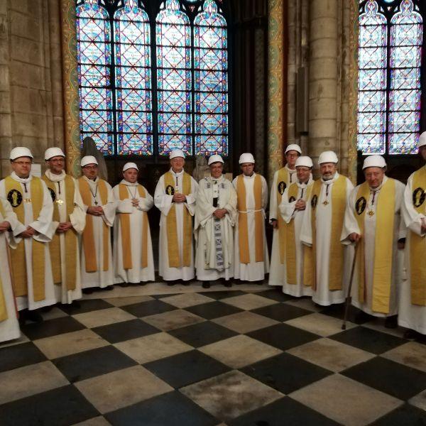 The Archbishop of Paris Michel Aupetit (C) poses with other members of the clergy following the first mass in a side chapel, two months to the day after a devastating fire engulfed the Notre-Dame de Paris cathedral, on June 15, 2019, in Paris.(Credit: KARINE PERRET/AFP/Getty Images)