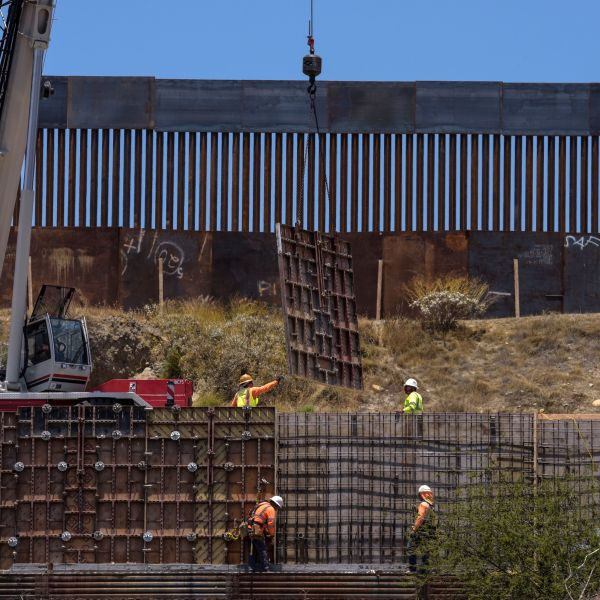Workers set up a second layer of wall along the U.S.-Mexico border in Tijuana on June 18, 2019. (Credit: Agustin Paullier / AFP / Getty Images)