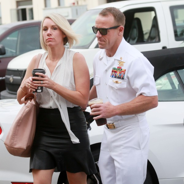 Navy Special Operations Chief Edward Gallagher walks into military court in San Diego with his wife Andrea Gallagher on June 21, 2019. (Credit: Sandy Huffaker / AFP / Getty Images)