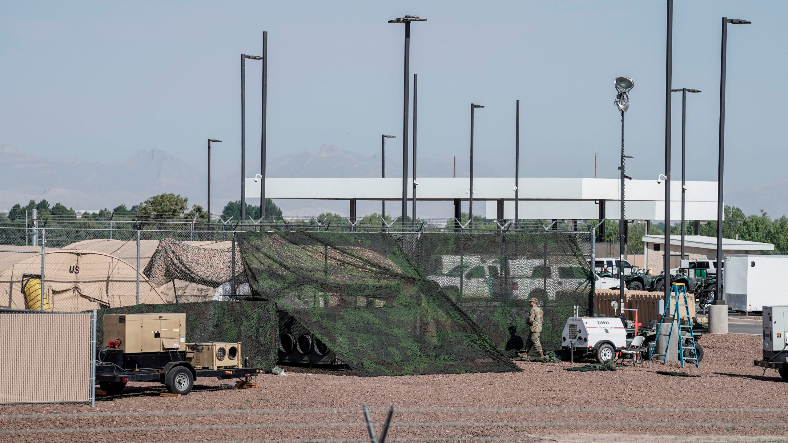 Military tents used to house migrants are pictured at the U.S.Customs and Border Protection facility is seen in Clint, Texas, on June 26, 2019. -The site held about 250 children in crowded cells, with limited sanitation and medical attention, as reported by a group of lawyers able to tour the facility under the Flores Settlement. (Credit: PAUL RATJE/AFP/Getty Images)