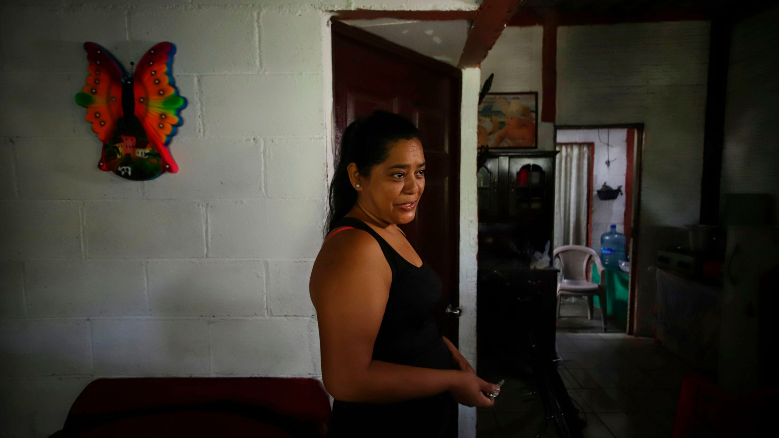 Salvadoran Rosa Ramirez speaks at her home in the populous Alta Vista neighborhood of San Martin, San Salvador municipality, El Salvador, on June 26, 2019. (Credit: Diego Lopez / AFP / Getty Images)