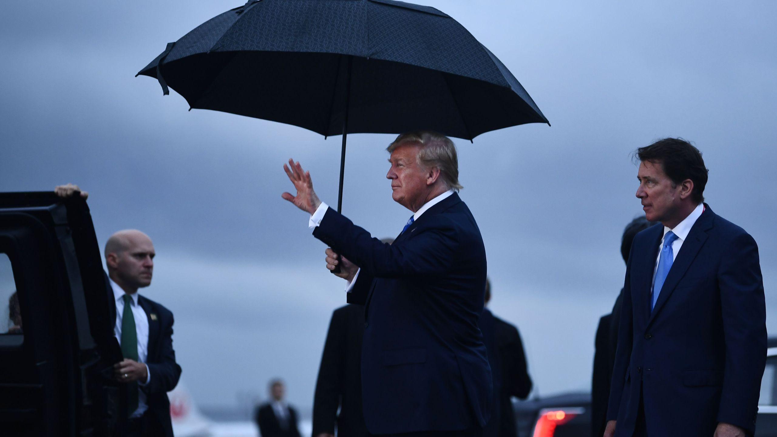 US President Donald Trump gestures as he arrives at Osaka International Airport in Itami, Hyogo prefecture, on June 27, 2019 ahead of the G20 Osaka Summit. (Credit: BRENDAN SMIALOWSKI/AFP/Getty Images)