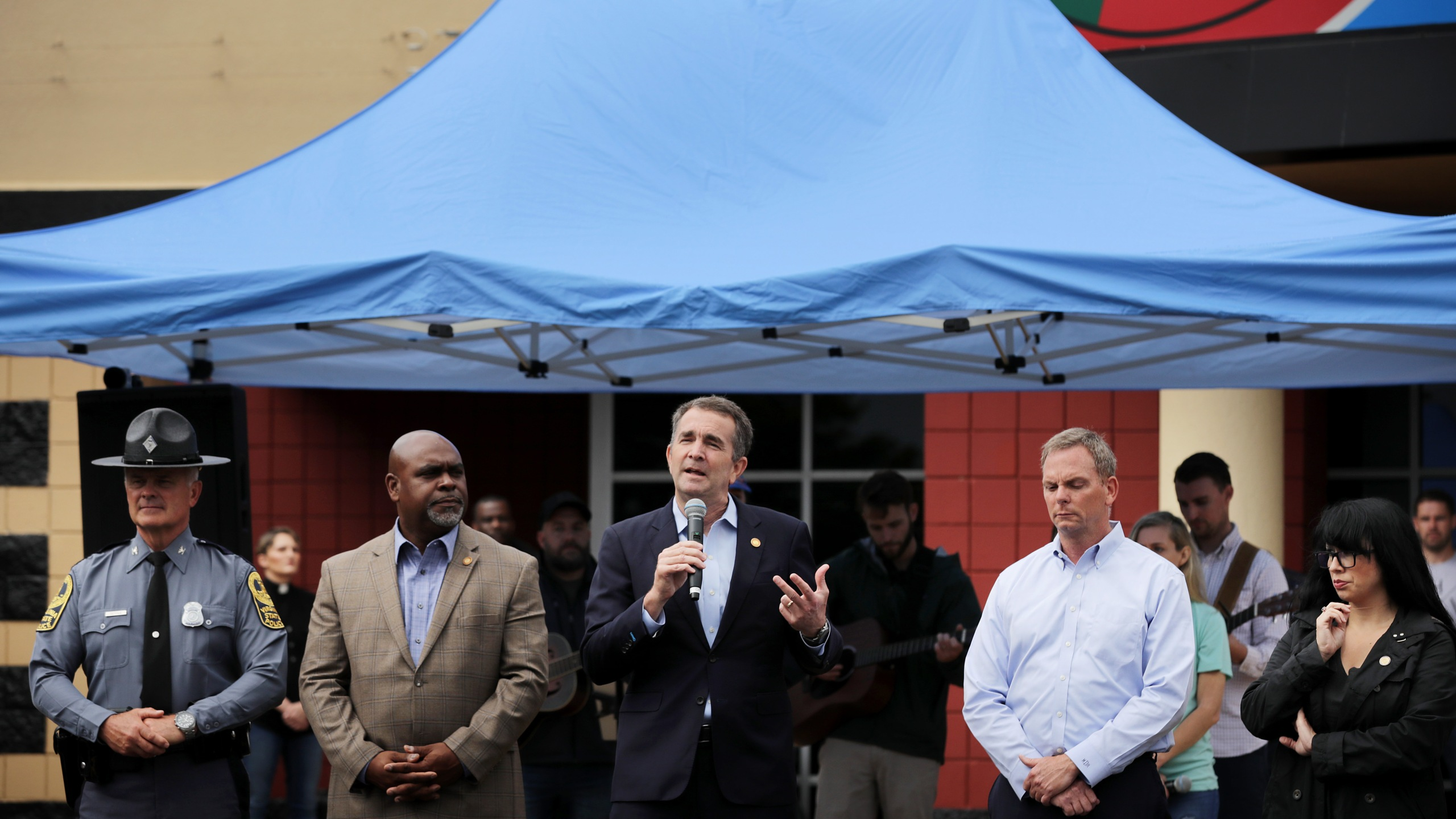 Gov. Ralph Northam, center, speaks during a public prayer service for mass shooting victims in Virginia Beach on June 1, 2019. (Credit: Chip Somodevilla/Getty Images)