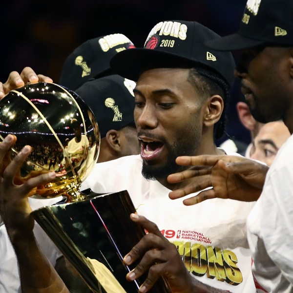 Kawhi Leonard #2 of the Toronto Raptors celebrates with the Larry O'Brien Championship Trophy after his team defeated the Golden State Warriors to win Game Six of the 2019 NBA Finals at ORACLE Arena on June 13, 2019 in Oakland, California. (Credit: Ezra Shaw/Getty Images)