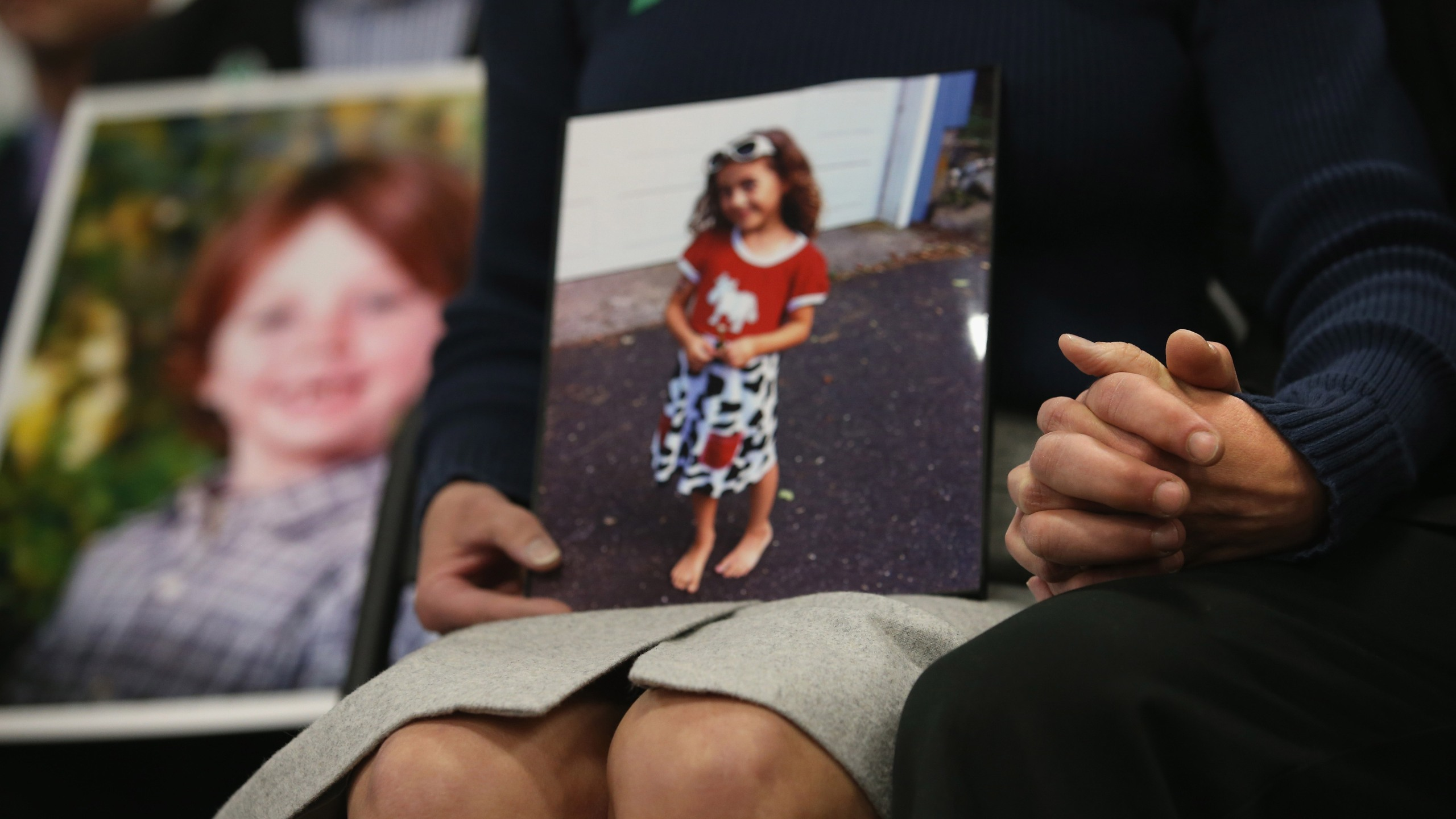 Parents of the Sandy Hook Elementary shooting victims hold hands on the one-month anniversary the massacre on Jan. 14, 2013 in Newtown, Connecticut. (Credit: John Moore/Getty Images)