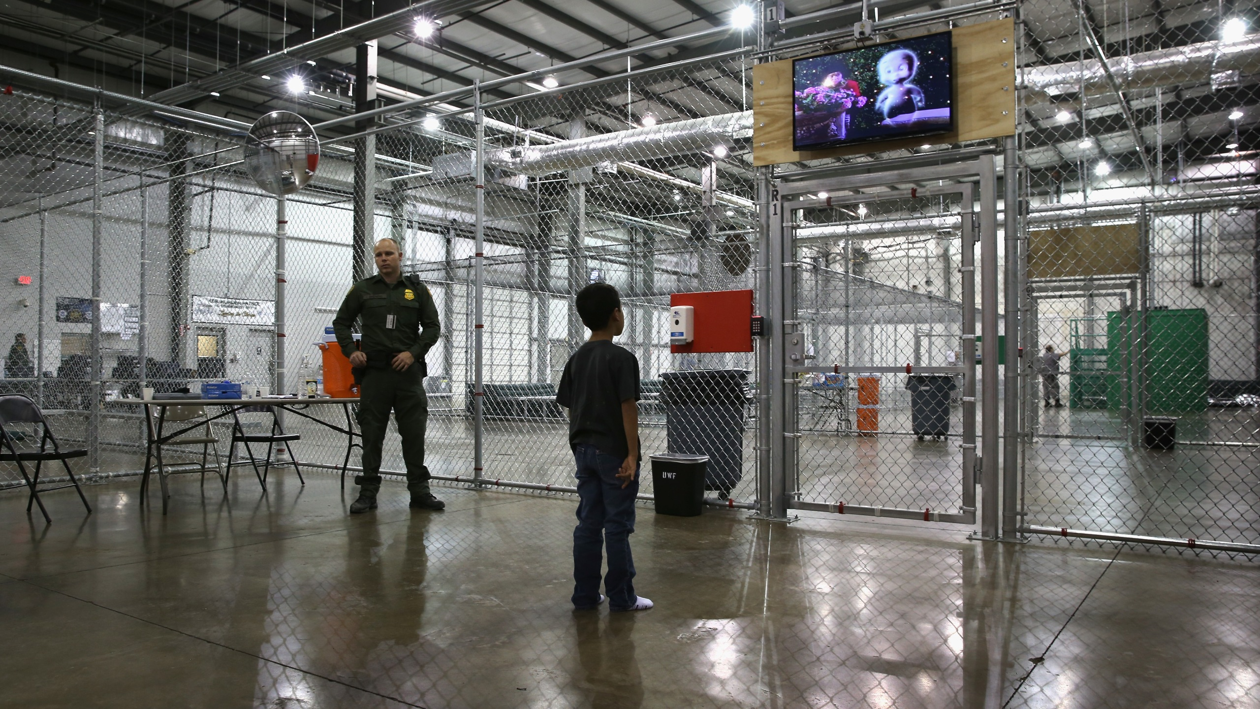 A boy from Honduras watches a movie at a detention facility run by the U.S. Border Patrol on Sept. 8, 2014, in McAllen, Texas. (Credit: John Moore/Getty Images)