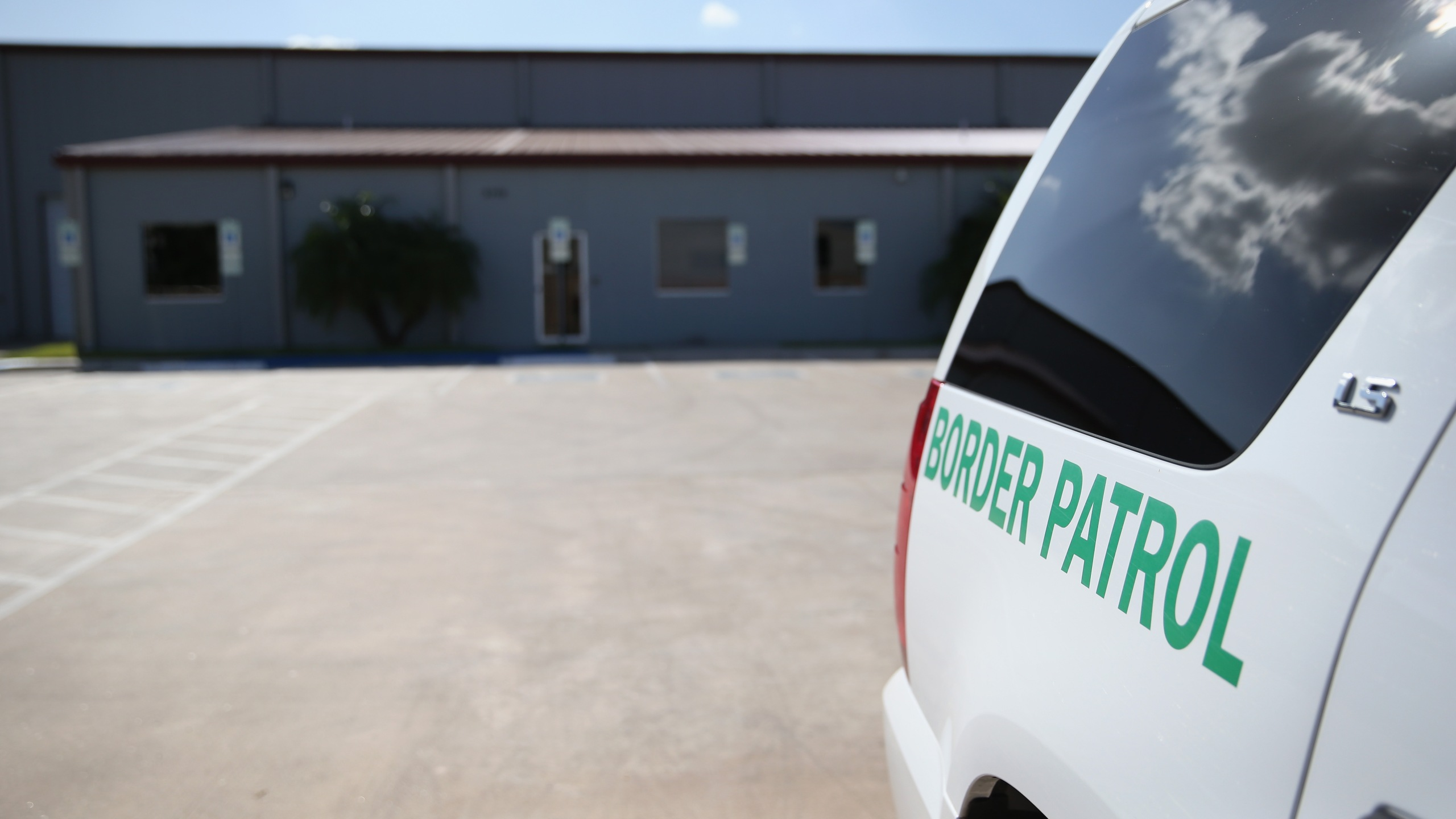 A U.S. Border Patrol vehicle sits parked outside a detention facility for unaccompanied minors on Sept. 8, 2014 in McAllen, Texas. (Credit: John Moore/Getty Images)