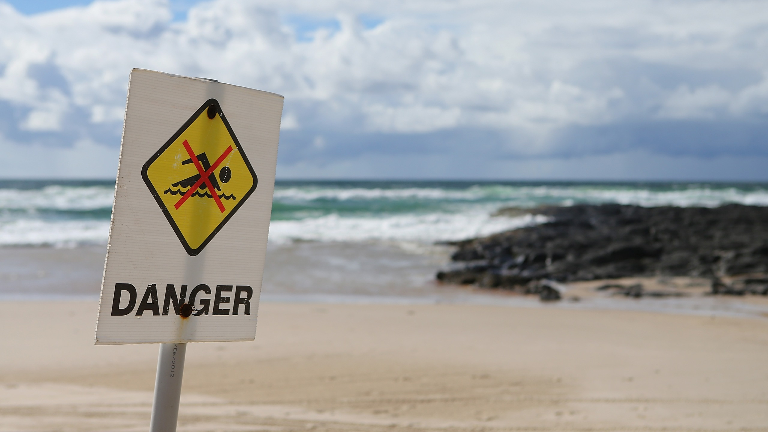 Danger signs have been put up along Shelly Beach on February 10, 2015 in Ballina, Australia. (Credit: Chris Hyde/Getty Images)