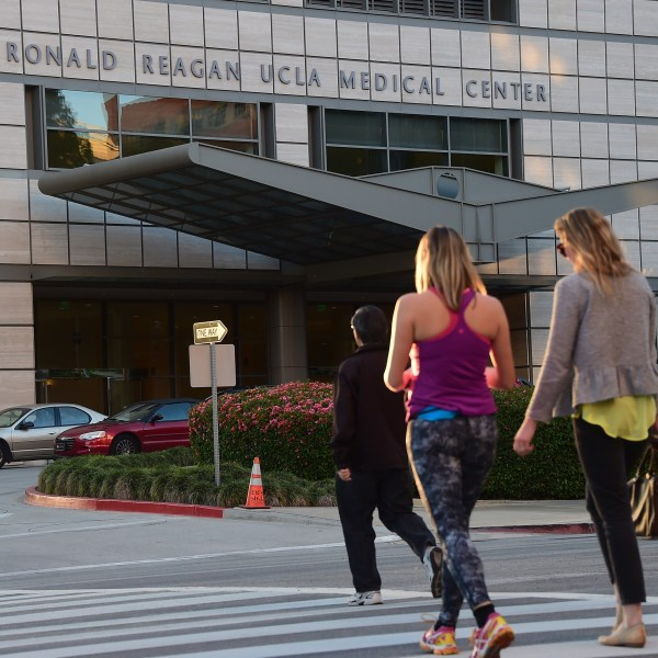 Pedestrians cross the road to the Ronald Reagan UCLA Medical Center in Westwood on March 5, 2015. (Credit: Frederic J. Brown / AFP / Getty Images)