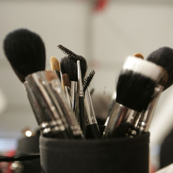 Makeup brushes sit in a cup backstage in this file photo. (Credit: Carlo Allegri/Getty Images)
