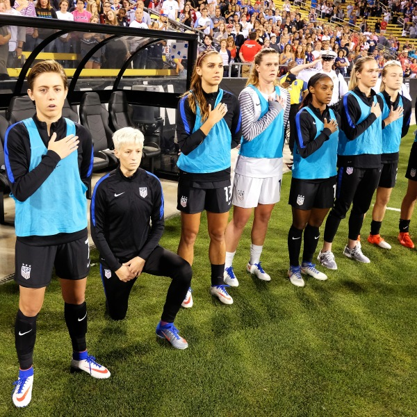 Megan Rapinoe of the U.S. Women's National Team kneels during the playing of the U.S. National Anthem before a match on September 15, 2016 in Columbus, Ohio. (Credit: Jamie Sabau/Getty Images)