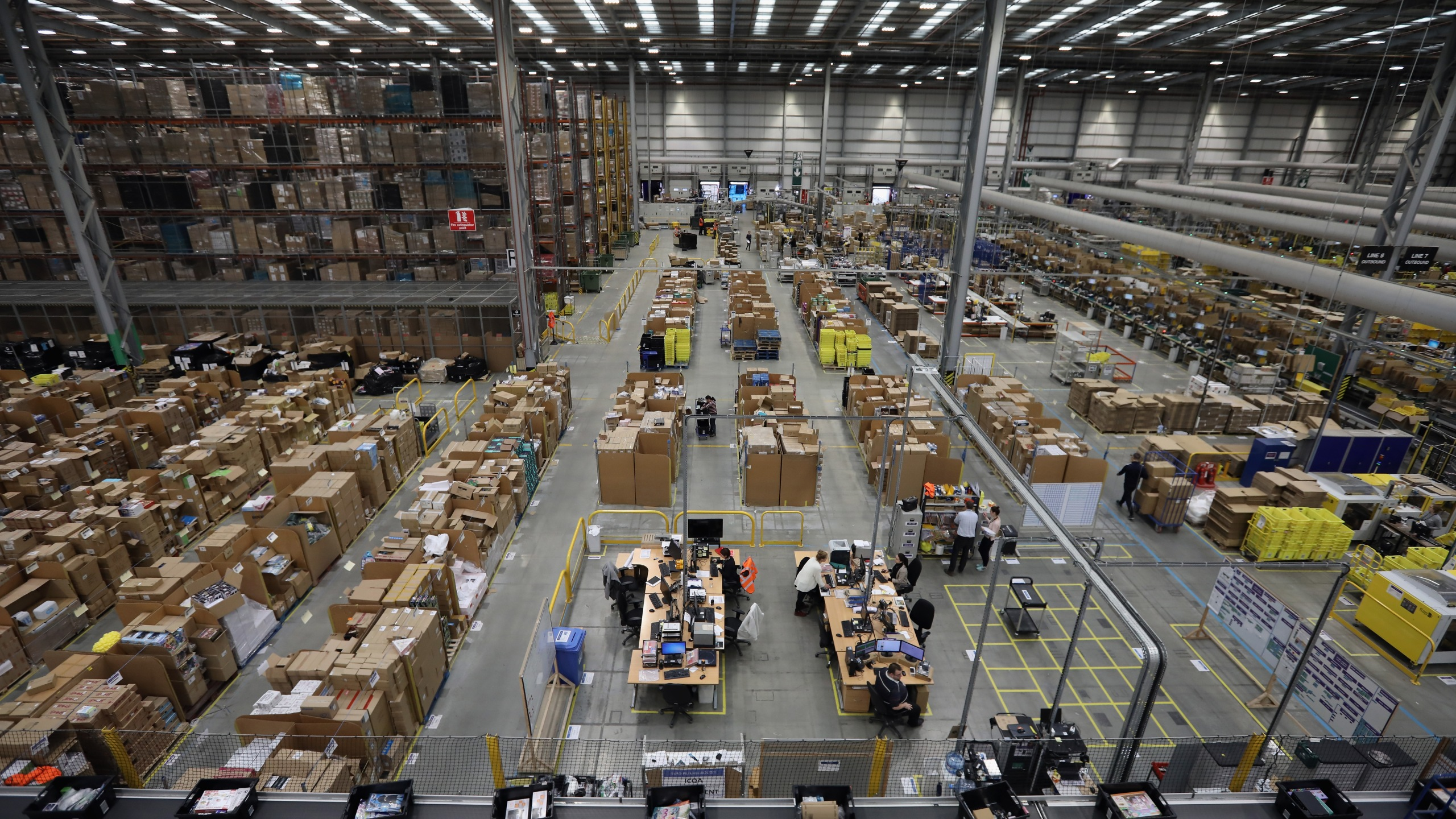 Parcels are processed and prepared for dispatch at Amazon's fulfillment centre on November 15, 2016 in Peterborough, England. (Credit: Dan Kitwood/Getty Images)