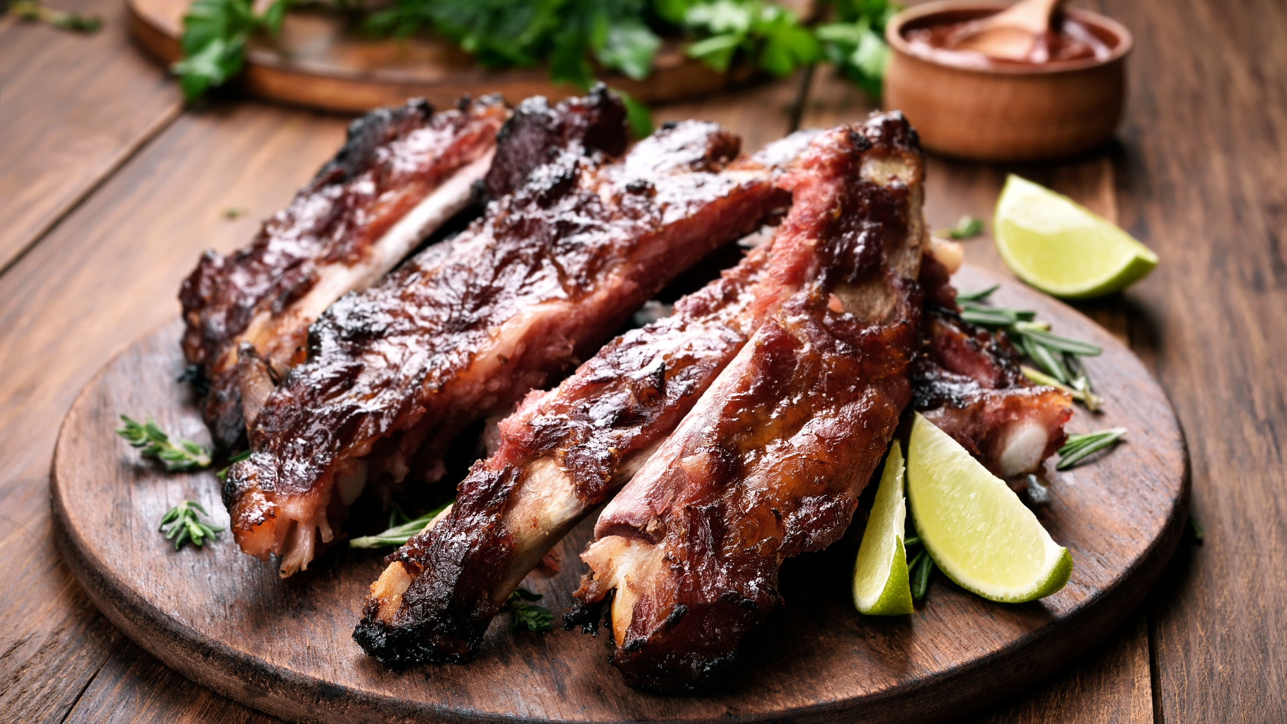Grilled barbecue pork ribs on wooden board. (Credit: iStock / Getty Images Plus)