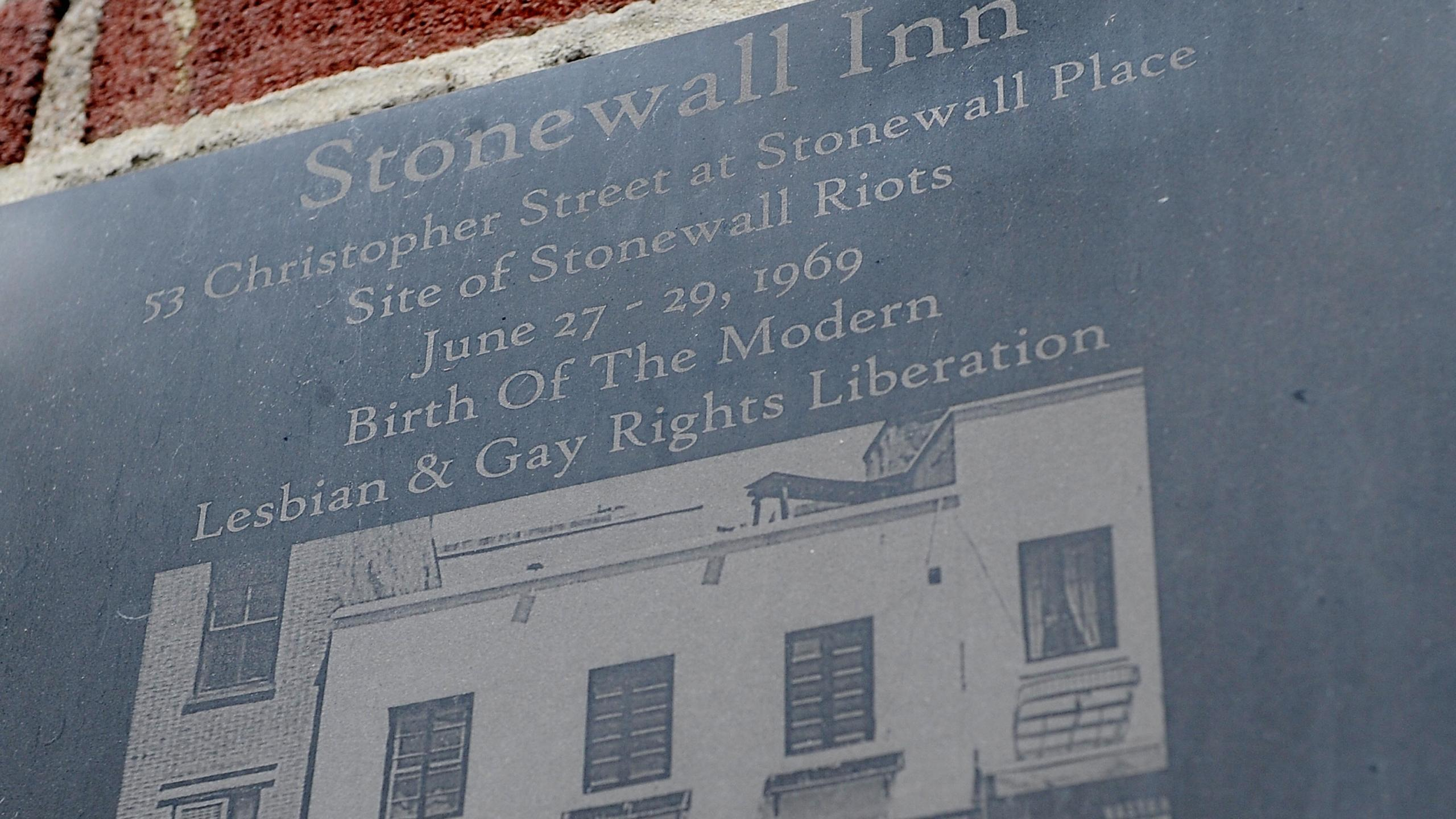 A plaque marks the site of the Stonewall riots at the Stonewall Inn in New York City on June 23, 2009. (Credit: STAN HONDA/AFP/Getty Images)