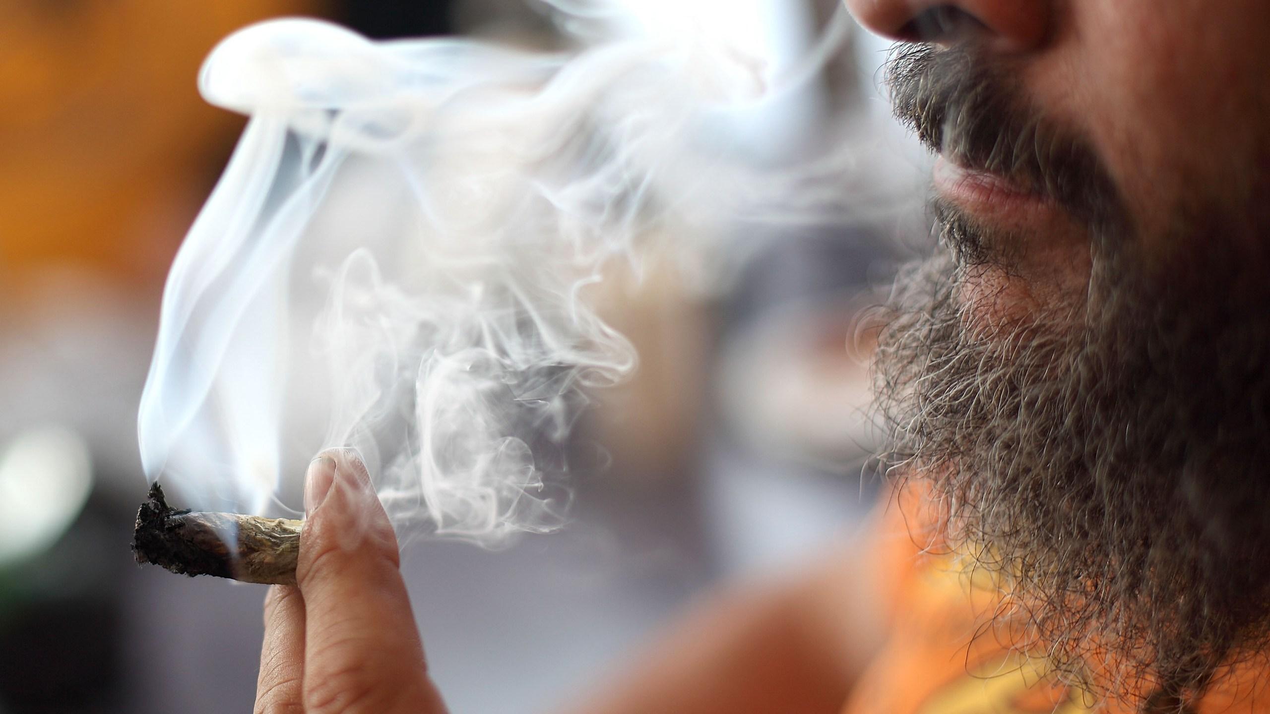 Medicinal marijuana user Dave Karp smokes the drug at the Berkeley Patients Group March 25, 2010, in Berkeley, Calif. (Credit: Justin Sullivan/Getty Images)