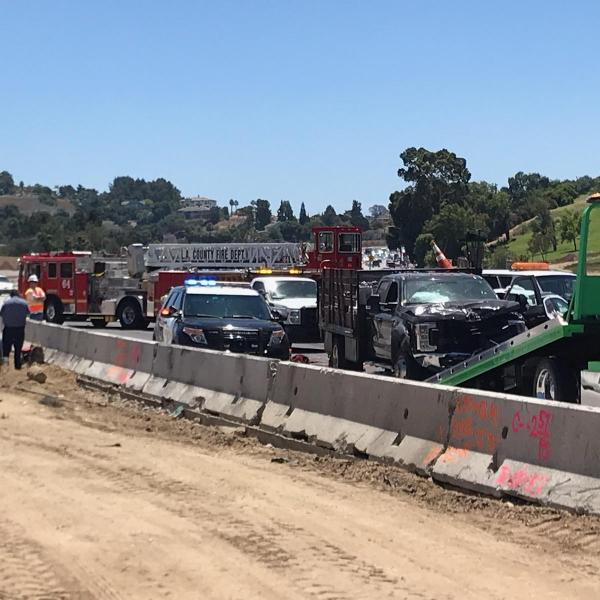 Officials and firefighters respond to a deadly crash on the 10 Freeway in the Pomona area on June 30, 2019. (Credit: KTLA)