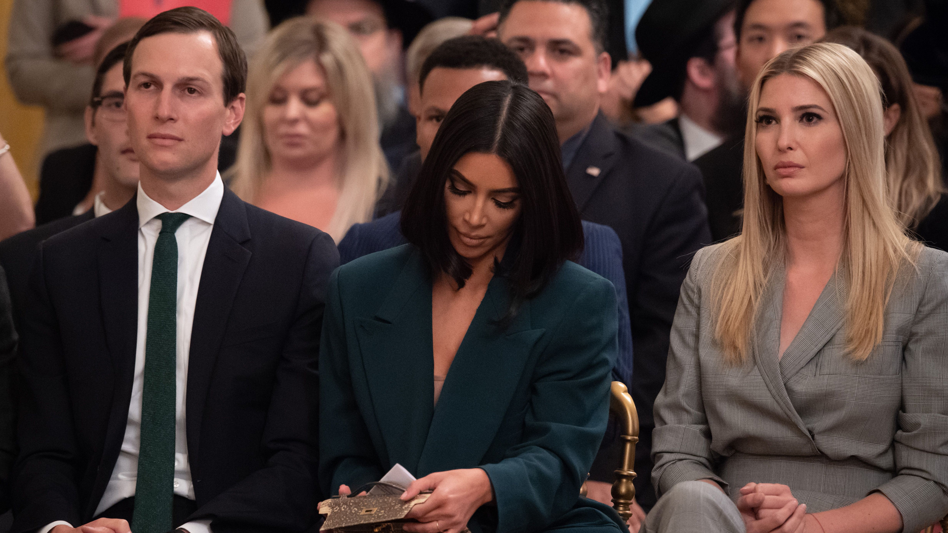 Kim Kardashian(C), Ivanka Trump and Jared Kushner listen as US President Donald Trump speaks about second chance hiring and criminal justice reform in the East Room of the White House in Washington, DC, June 13, 2019. (Credit: Saul Loeb/AFP/Getty Images)