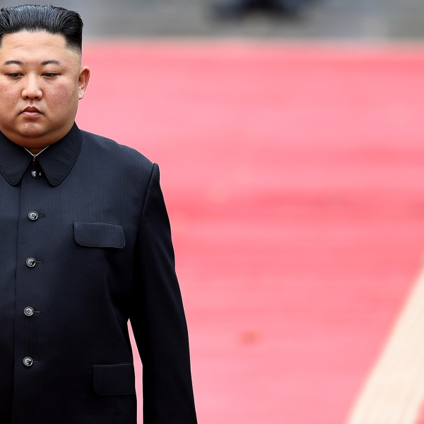 North Korea's leader Kim Jong Un attends a welcoming ceremony and review an honour guard at the Presidential Palace in Hanoi on March 1, 2019. (Credit: Manan VatsayanaAFP/Getty Images)