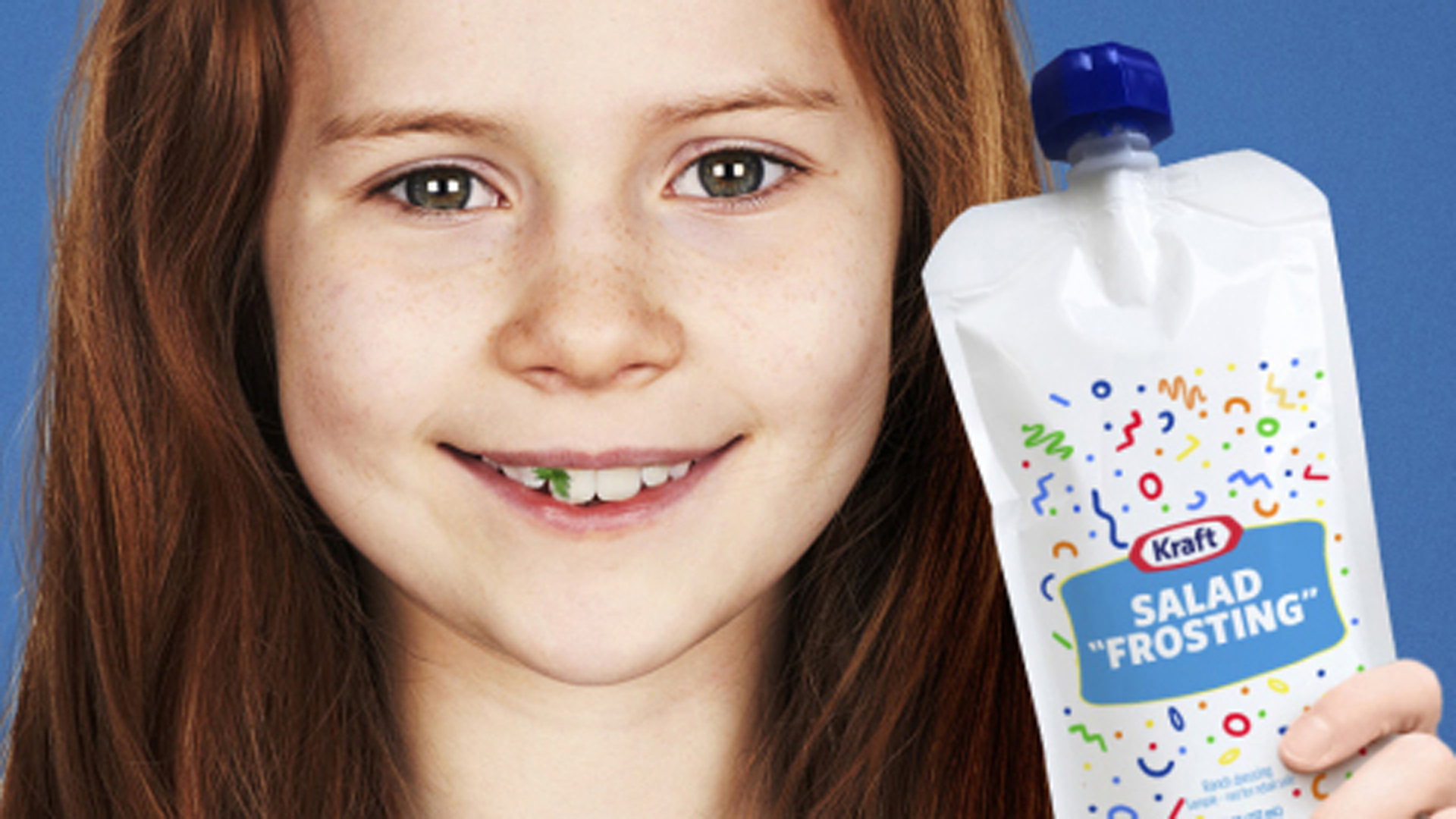 "A photo of a child holding Kraft's new ""salad frosting"" product is seen in a photo from the company."