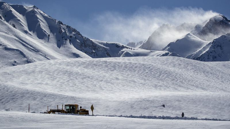 A snow plow clears a road near Highway 395 near Mammoth Lakes, Calif., after heavy snow blanketed the eastern Sierra Nevada mountains during a February storm. (Credit: Allen J. Schaben / Los Angeles Times)