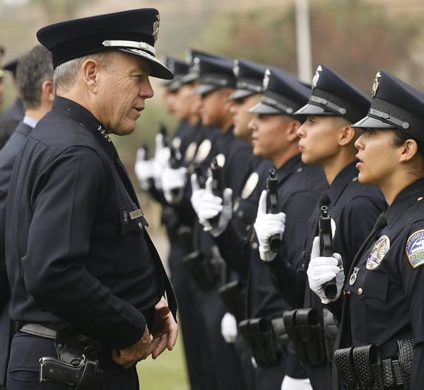 Los Angeles Police Chief Michel Moore speaks to an officer in this file photo. (Credit: Al Seib / Los Angeles Times)