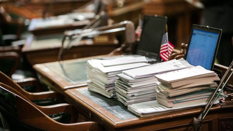 A stack of legislative bills piled up on a lawmaker's desk in the California Assembly in this undated photo. (Credit: Marcus Yam / Los Angeles Times)