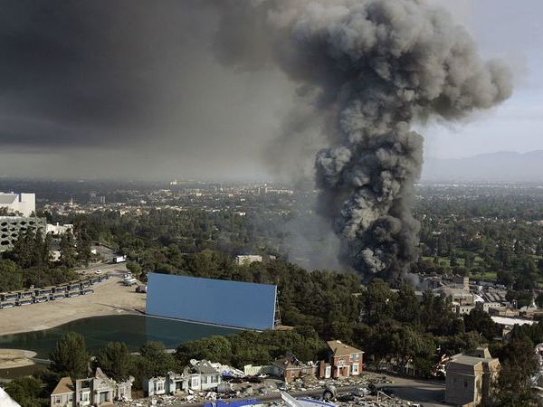 A thick plume of smoke rises from a fire at Universal Studios Hollywood on June 1, 2008. The blaze destroyed several original master recordings held inside a storage facility, which were made by some of the biggest names in music. (Credit: Gary Friedman / Los Angeles Times)