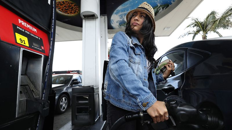 A Sherman Oaks woman fills up gas in an undated photo. (Credit: Mel Melcon / Los Angeles Times)