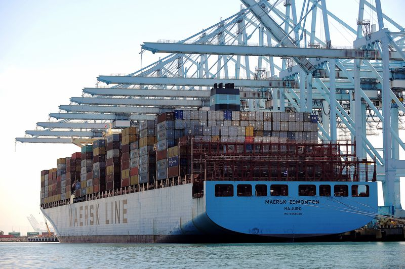 cargo is unloaded from a Maersk ship at the terminal. (Christina House / Los Angeles Times)