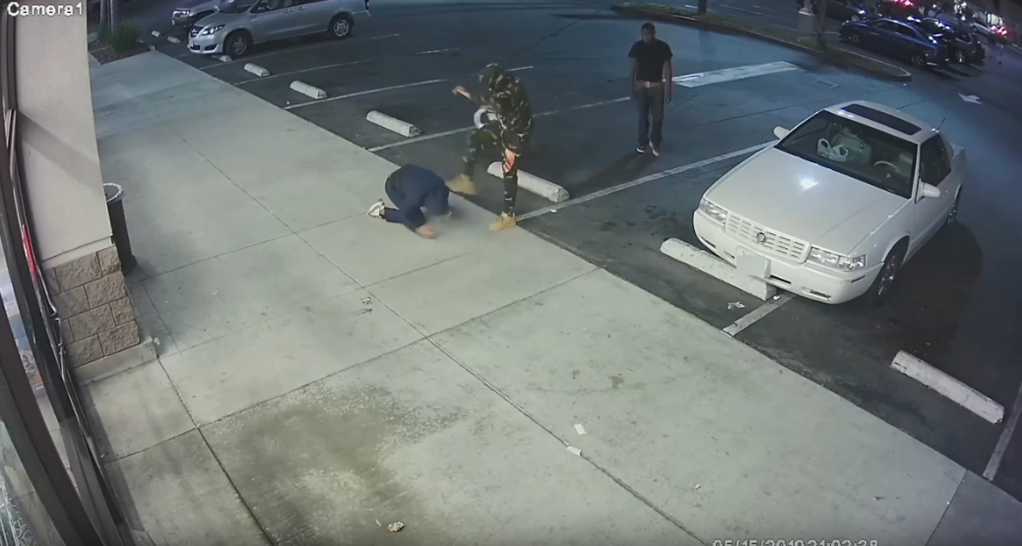 A robbery suspect was caught on video assaulting a victim on May 15, 2019 in this still from video provided by Long Beach police.
