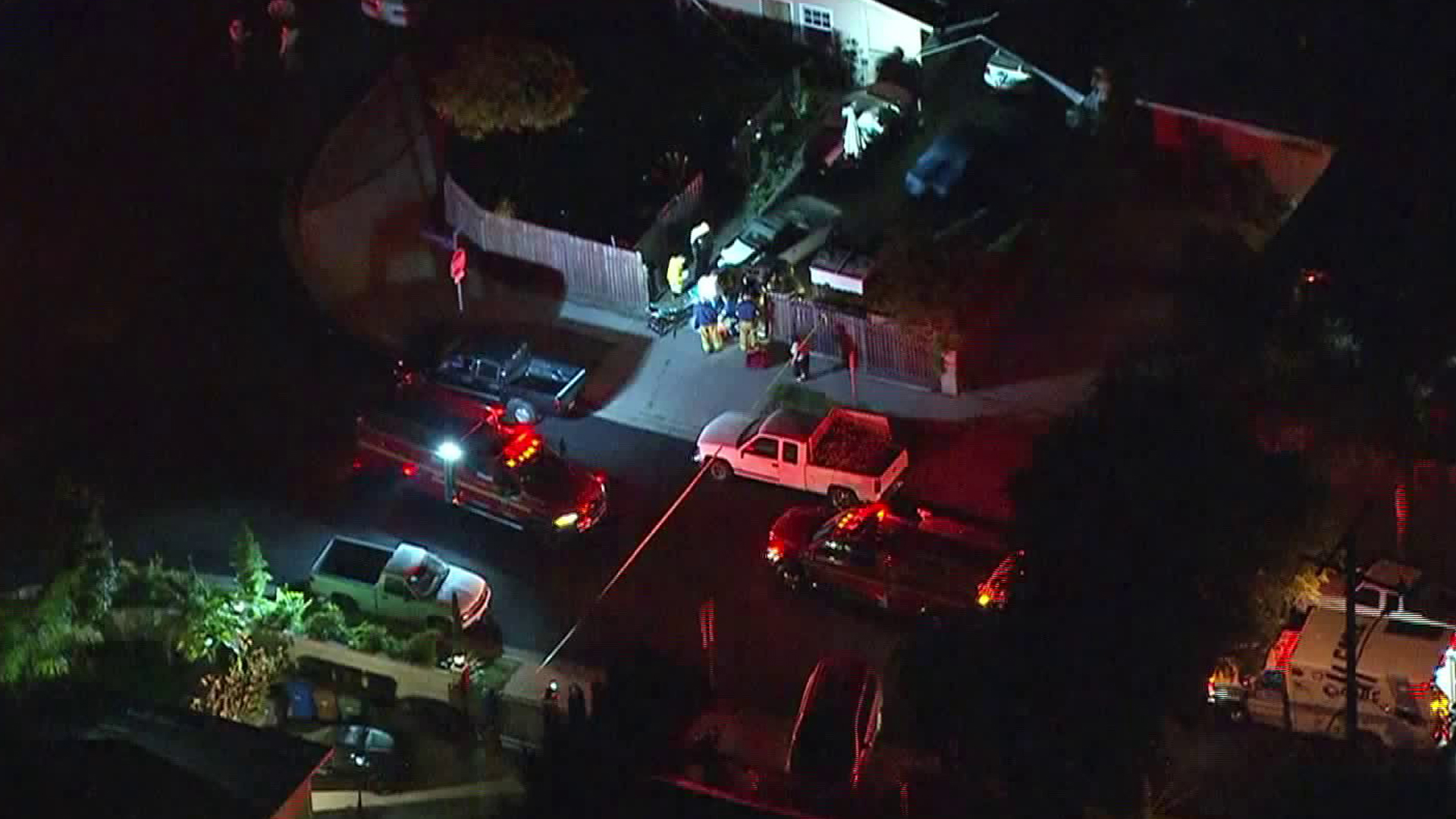 Deputies and firefighters work at the scene of a shooting that left one man dead and another wounded at Winton Avenue and Gemini Street in La Puente on June 28, 2019. (Credit: KTLA)