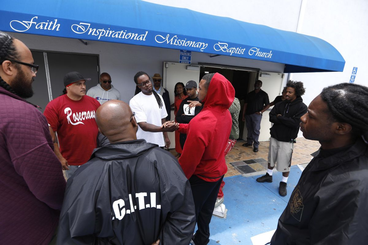 Leaders of gangs affiliated with the notorious Bloods and Crips wish each other well after a cease-fire summit held at Compton's Faith Inspirational Missionary Baptist Church in April 2019. The rivals have been inspired to come together in the aftermath of South L.A. rapper Nipsey Hussle's death in March. (Credit: Genaro Molina / Los Angeles Times)