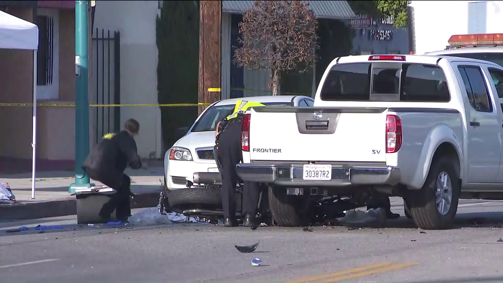 Officials investigate the scene of a fatal crash involving a motorcycle and a truck at Magnolia Boulevard and Cartwright Avenue in North Hollywood on June 7, 2019. (Credit: KTLA)
