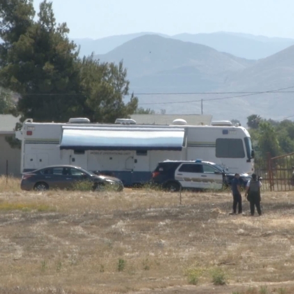 Detectives investigate the scene of a fatal deputy involved shooting at Menifee Road and Garland Lane in Menifee on June 9, 2019. (Credit: RVCNEWS)