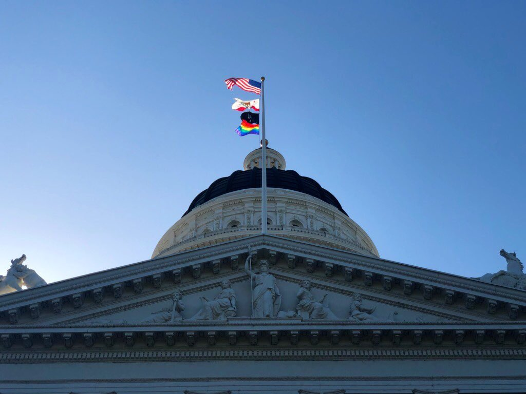 The LGBTQ rainbow flag is flies over the State Capitol building in Sacramento on June 17, 2019. (Credit: Gavin Newsom/Twitter)