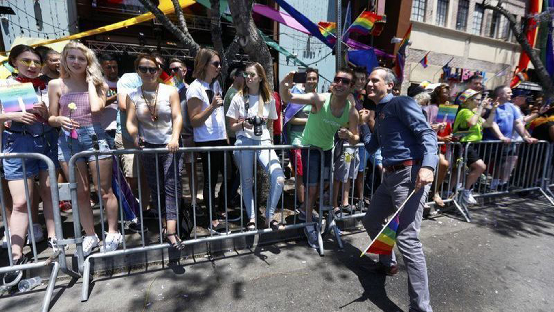 Los Angeles Mayor Eric Garcetti, right, greets the crowd at the 2018 LA Pride Parade in West Hollywood. (Credit: Francine Orr / Los Angeles Times)