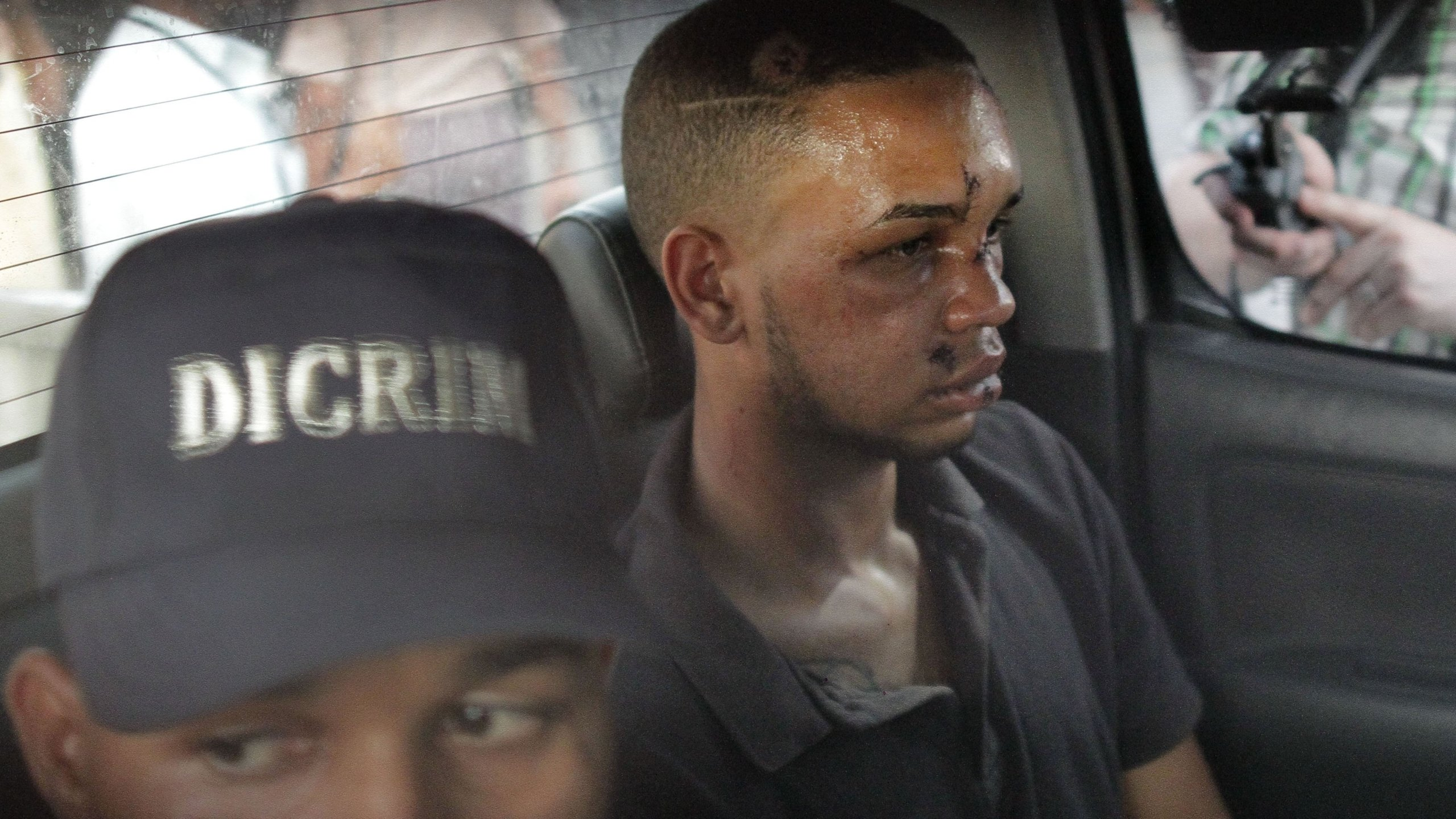 Eddy Vladimir Féliz Garcia, in custody in connection with the shooting of former Boston Red Sox slugger David Ortiz, is transferred by police to court. (Credit: Roberto Guzman/AP)