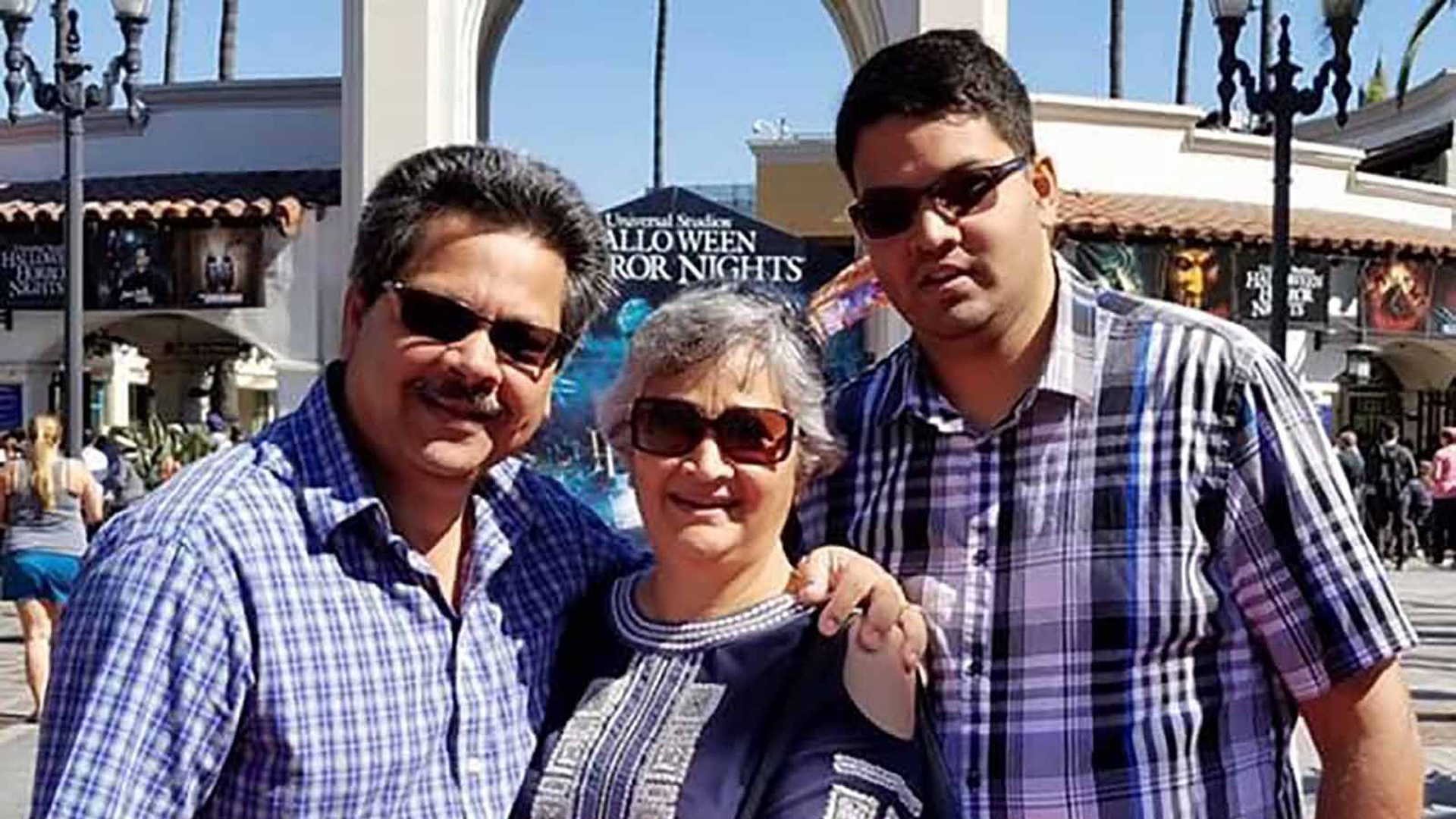 Shooting victim Kenneth French (right) and his parents, Russell and Paola French. (Credit: Courtesy Rick Shureih via CNN Wire)