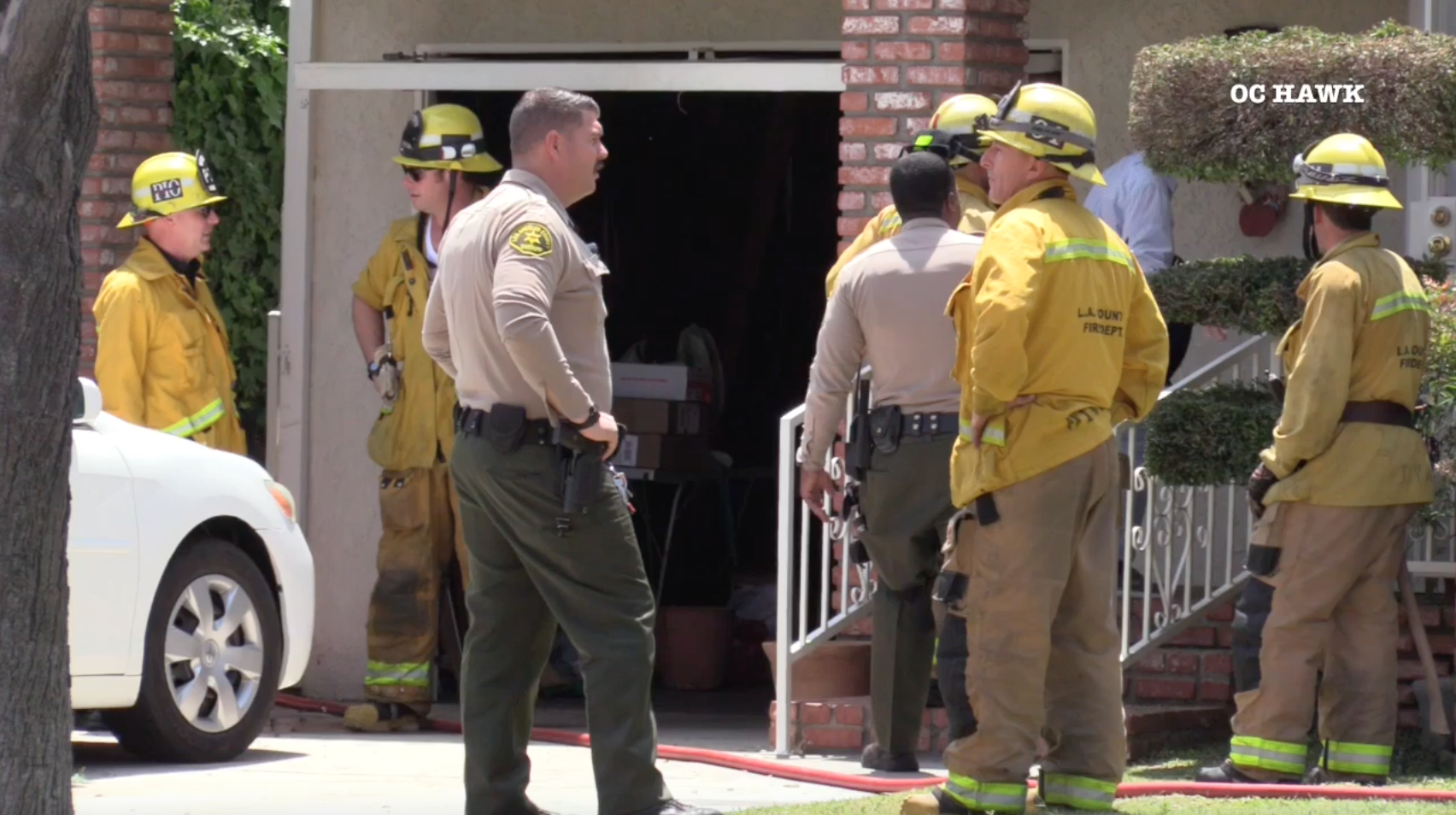 Authorities investigate a Lakewood home where a man died in a fire on June 4, 2019. (Credit: OC Hawk)