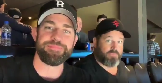 John Krasinski appears with David Denman in a video posted to Twitter.