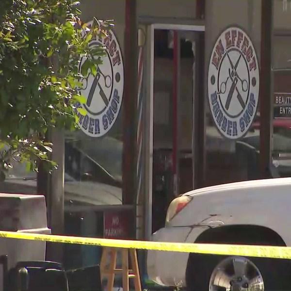 A barber shop in Hawthorne is blocked off by crime tape after a shooting on June 28, 2019. (Credit: KTLA)
